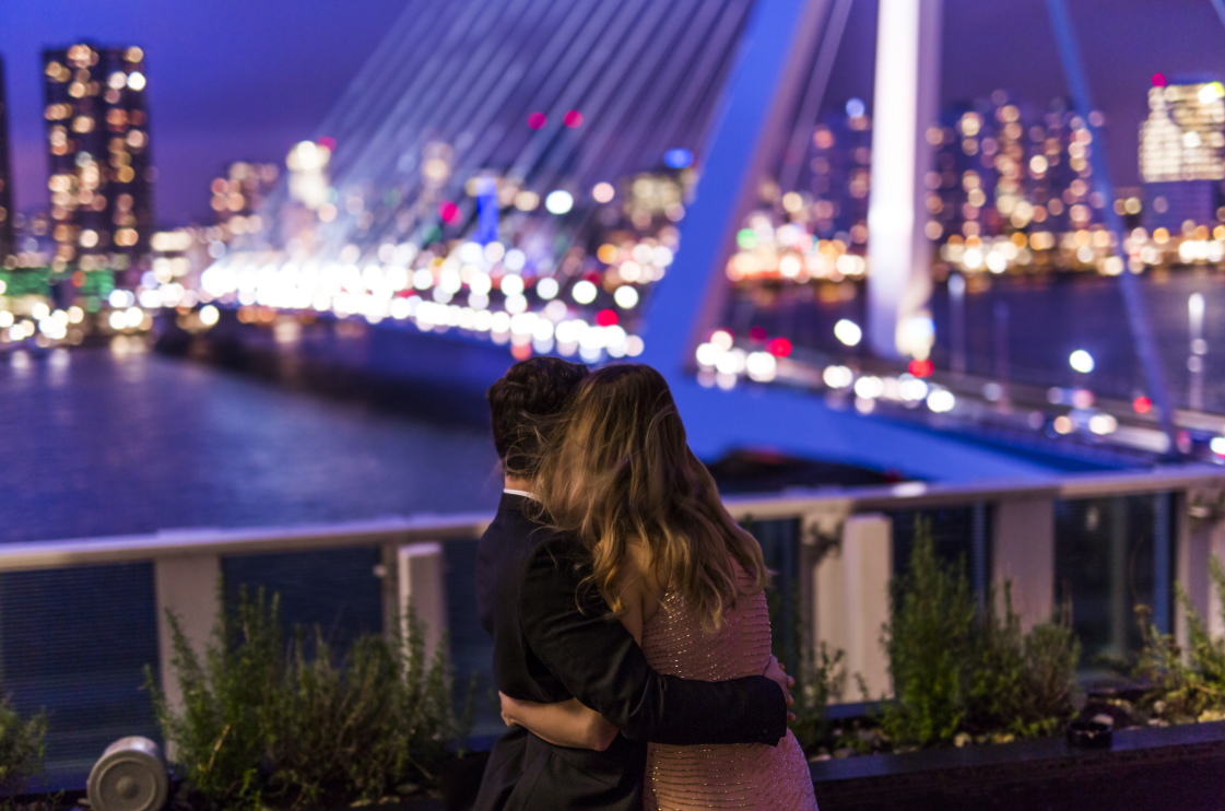 Couple hugging admiring skyline view from rooftop terrace nhow hotel rotterdam